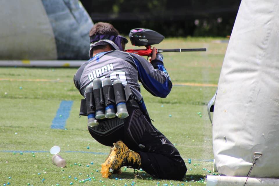 team member posted behind bunker shooting on new turf field